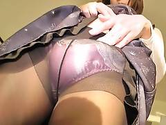 Always rock hard and ready for action, she gets down and dirty in her 18th exclusive as she teases out her pulsating length from within her pantyhose and spoils us with an eye popping display of spread ass, upskirt tomfoolery!