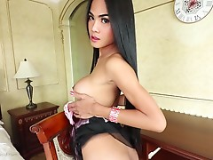 Poy sits on the chair of the desk on her knees and pulls her sheer panties down to show her to tight little asshole. I move Poy to the bed to start sucking my cock. She gives me a nice long licking and sucking session. I then bend Poy over, oil her ass up