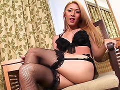 Tgirl Karina looks so sultry in her black stockings, bra, and garter. The nice thing about this hot blonde doll is that she`s naturally playful in front of the camera. She captures the viewers' attention even when she poses more provocatively by showing o