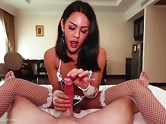 I pull my cock out and give it to Lanta to start sucking on. Once its rock hard she begins playing with it and then licking and sucking more. I then lie back and get treated to a nice wet coconut oil handjob and blowjob. I oil up Lanta`s tits and have her