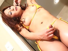 Miwa has plenty of nice things to show and we're ready to watch her display it. She starts her scene in her new yellow bikini, then undresses to expose her very large and throbbing cock. Watch her whips her cock out and strokes it hard for you.